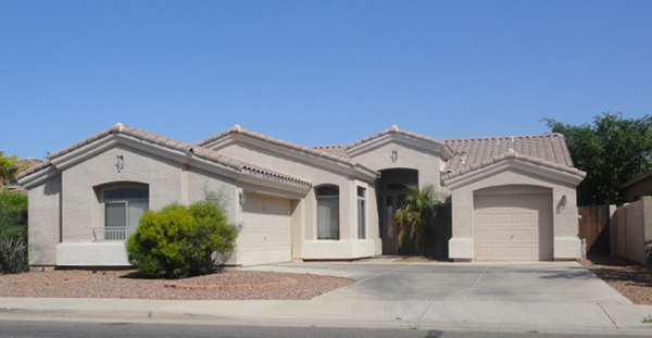 This typical suburban Phoenix home sits in a sea of concrete, asphalt, and granite ground cover; not surprisingly, this community is void of pedestrian users.