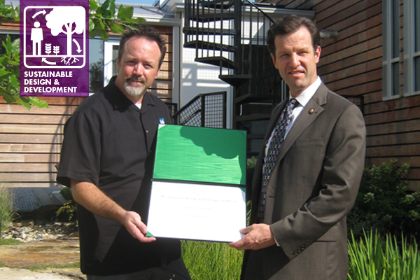 Representative Carnahan receiving his ASLA Honorary Membership from Saint Louis Chapter Trustee, Hunter Beckham, in a SITES Pilot Project rain garden.