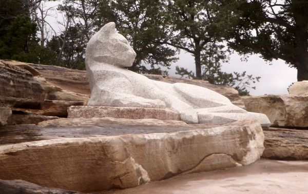 Granite mountain lion sculpture