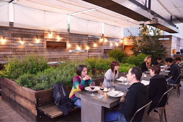 Bar Agricole is a restaurant in San Francisco where outdoor diners sit among the herb gardens. The herbs are used by the chef in food and cocktails. image: April Philips