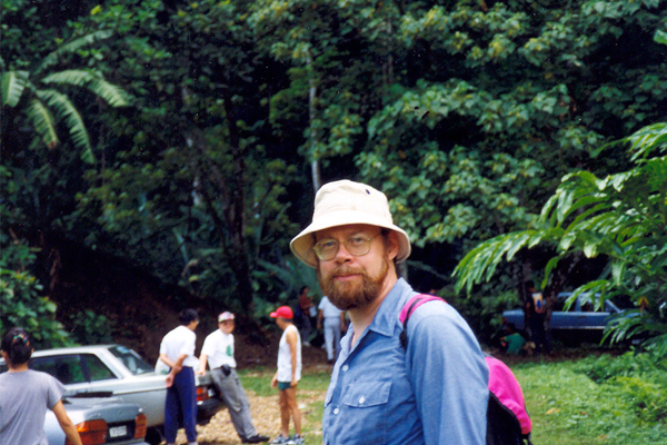 "Erik Mustonen at a trailhead for Malaysian primary forest (""jungle"")  image: Erik Mustonen"