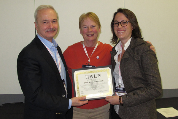 Honorable Mention winners Helen Erickson and Brianna Lehman accepting the award from Paul Dolinsky, Chief of HALS. image: Chris Stevens