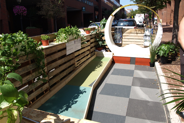 Urban Land Institute's parklet, designed by Lancaster Architects, included seating, mini-golf, and shipping palette walls image: Alexandra Hay