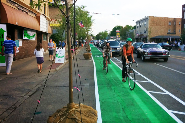 A temporary bike lane with street trees installed in Akron's first Better Block image: Jason Roberts