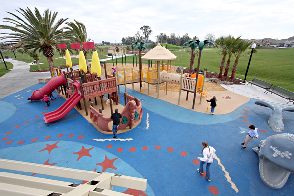 Sailing ship play structures, palm trees, and a precast whale climber set the scene for deserted-island adventures in Shasta Park in Sacramento, CA, designed by Callander Associates. image: Billy Hustace