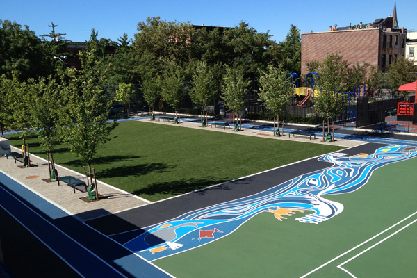 Renovations at Brooklyn's P.S. 261 added an artificial turf field, rain gardens to absorb runoff, a gazebo with green roof, rain barrels for irrigation water, and permeable paving. All told, the half-acre park can capture about 500,000 gallons of stormwater annually. image: Pedro Diez