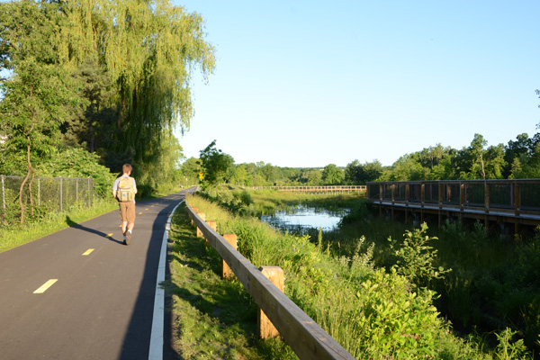A multi-agency partnership in Cambridge, Massachusetts converted the underutilized Alewife Reservation to a large engineered wetland (which can absorb and clean 3 million gallons of runoff per storm) with enhanced recreational opportunities, including a bike path and long boardwalks. image: MWH Global