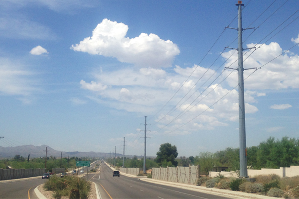 Figure 11: Galvanized poles with a matte finish that contrasts minimally with the sky. La Canada Drive in northwest Tucson area. View to the Santa Rita mountain range. image: Ellen Alster