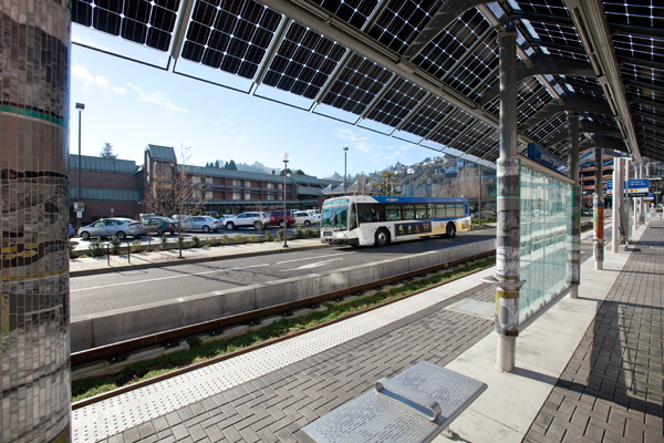 TriMet's Portland-Milwaukie Light Rail Transit Project (PMLR). Note the photovoltaic cells on shelter roofs. image: ©2015 Tim Jewett / Trimet