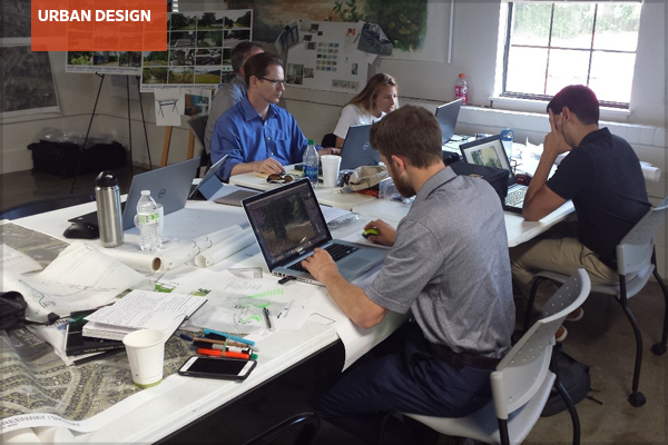 Interdisciplinary team members at work in a charrette studio